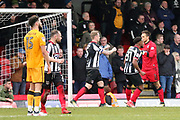 Grimsby Town goalkeeper James McKeown (1) is congratulated by Grimsby Town midfielder Reece Hall Johnson (31) and Grimsby Town defender Nathan Clarke (5) after saving a penatly during the EFL Sky Bet League 2 match between Grimsby Town FC and Port Vale at Blundell Park, Grimsby, United Kingdom on 10 March 2018. Picture by Mick Atkins.