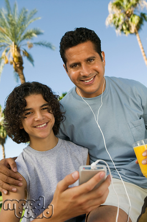 Father and Son Listening to MP3 Player