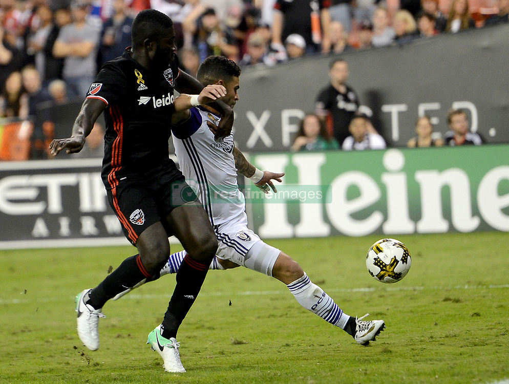 September 9, 2017 - Washington, DC, USA - 20170909 - Orlando City FC forward DOM DWYER (18) takes a shot while fending off D.C. United defender KOFI OPARE (6) in the second half at RFK Stadium in Washington. (Credit Image: © Chuck Myers via ZUMA Wire)