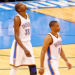 Jun 14, 2012; Oklahoma City, OK, USA; Oklahoma City Thunder small forward Kevin Durant (35) and point guard Russell Westbrook (0) during the fourth quarter of game two in the 2012 NBA Finals against the Miami Heat at Chesapeake Energy Arena. Miami won 100-96. Mandatory Credit: Derick E. Hingle-US PRESSWIRE