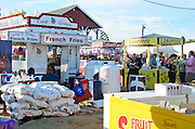 Behind the scenes at the Blue Hill Fair - stacked bags of potatoes, propane tanks, gallons of ketchup, and other supplies.