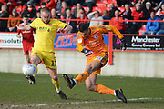 Accrington Stanley goalkeeper Dimitar Evtimov (30)  clears the ball under pressure from Accrington Stanley midfielder Erico Sousa (17) during the EFL Sky Bet League 1 match between Accrington Stanley and Fleetwood Town at the Fraser Eagle Stadium, Accrington, England on 30 March 2019.