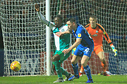 Ian Henderson looks to win the ball in the penalty area during the EFL Sky Bet League 1 match between Rochdale and Plymouth Argyle at Spotland, Rochdale, England on 15 December 2018.
