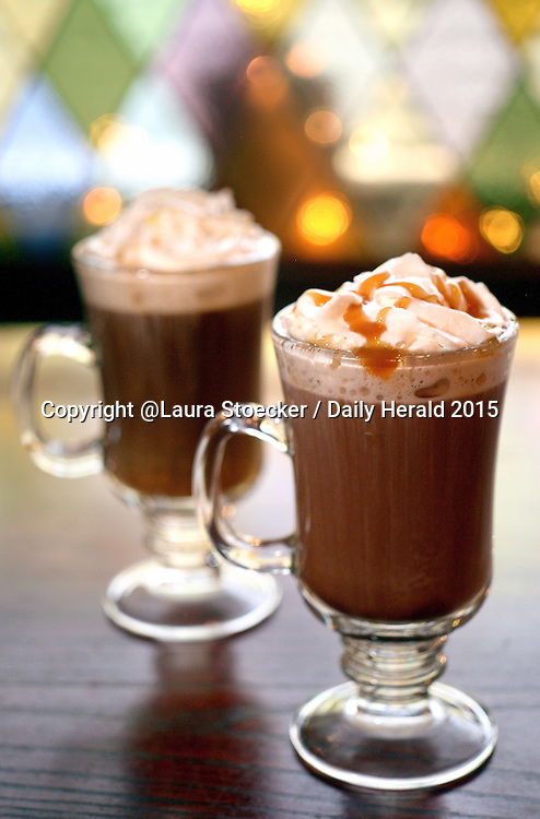 Laura Stoecker/lstoecker@dailyherald.com<br /> Hot Scotch Irish Cream (foreground) and Bailey's Coffee at Claddaugh Irish Pub in Geneva. Hot Scotch is butterscotch schnapps and hot cocoa topped with homemade whipped cream and a caramel drizzle. Bailey's Coffee contains Bailey's Irish Cream, freshly brewed hot coffee and homemade whipped cream.