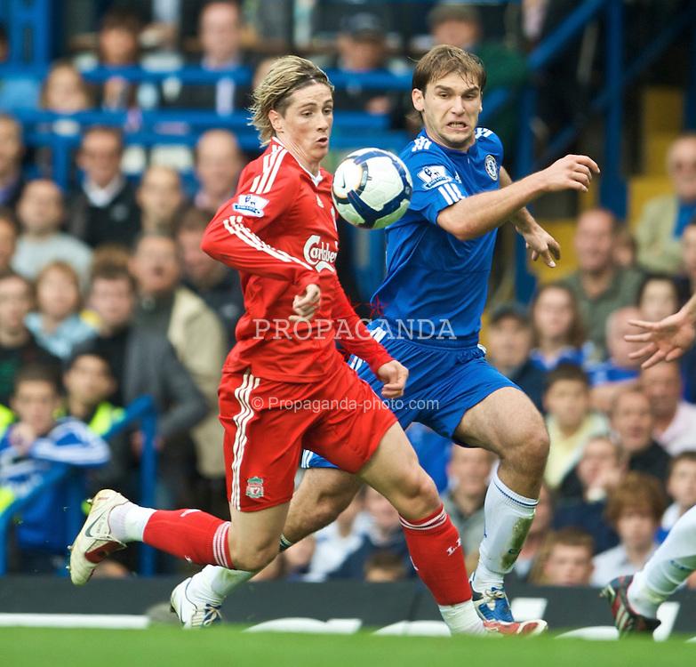 LONDON, ENGLAND - Sunday, October 4, 2009: Liverpool's Fernando Torres and Chelsea's Branislav Ivanovic during the Premiership match at Stamford Bridge. (Pic by David Rawcliffe/Propaganda)