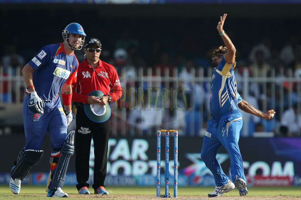 Lasith Malinga of the Mumbai Indians bowls as Kevin Pietersen captain of of the Delhi Daredevils looks on during match 16 of the Pepsi Indian Premier League 2014 between the Delhi Daredevils and the Mumbai Indians held at the Sharjah Cricket Stadium, Sharjah, United Arab Emirates on the 27th April 2014<br /> <br /> Photo by Ron Gaunt / IPL / SPORTZPICS