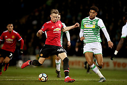 Manchester United's Scott McTominay (left) and Yeovil Town's Omar Sowunmi (right) battle for the ball during the Emirates FA Cup, fourth round match at Huish Park, Yeovil.