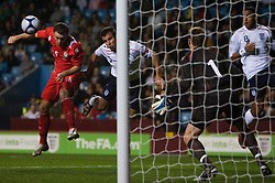 BIRMINGHAM, ENGLAND - Tuesday, October 14, 2008: England's Steven Taylor scoring the second goal against Wales as Darcy Blake defending tries to stop him during the UEFA European Under-21 Championship Play-Off 2nd Leg match at Villa Park. (Photo by Chris Ratcliffe/Propaganda)