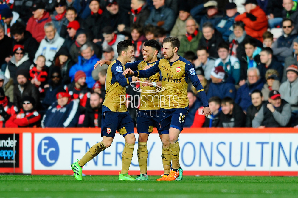 Arsenal midfielder Alex Oxlade-Chamberlain celebrates scoring with team mated Arsenal midfielder Mesut Ozil and Arsenal midfielder Aaron Ramsey during the Barclays Premier League match between Bournemouth and Arsenal at the Goldsands Stadium, Bournemouth, England on 7 February 2016. Photo by Graham Hunt.