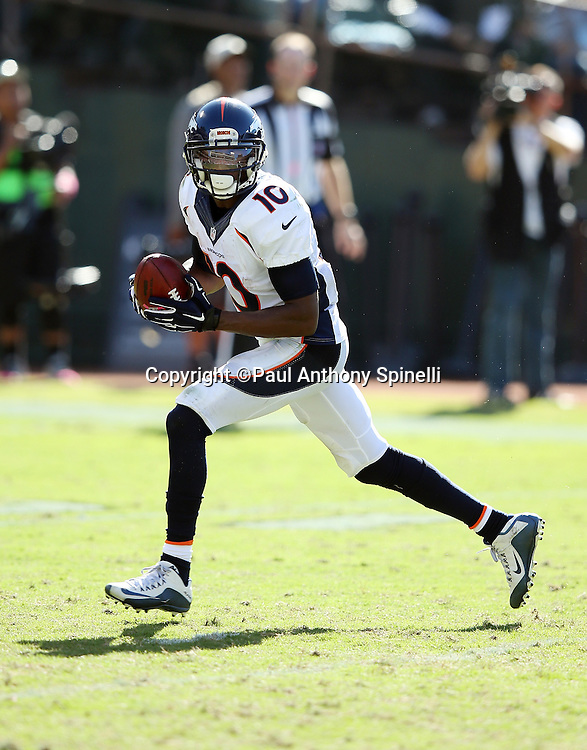 Denver Broncos wide receiver Emmanuel Sanders (10) catches a punt during the 2015 NFL week 5 regular season football game against the Oakland Raiders on Sunday, Oct. 11, 2015 in Oakland, Calif. The Broncos won the game 16-10. (©Paul Anthony Spinelli)