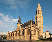 Collegiale Notre-Dame de Poissy, showing the Western bell tower and chapels of the North aisle, a catholic parish church founded c. 1016 by Robert the Pious and rebuilt 1130-60 in late Romanesque and early Gothic styles, in Poissy, Yvelines, France. Saint Louis was baptised here in 1214. The Collegiate Church of Our Lady of Poissy was listed as a Historic Monument in 1840 and has been restored by Eugene Viollet-le-Duc. Picture by Manuel Cohen