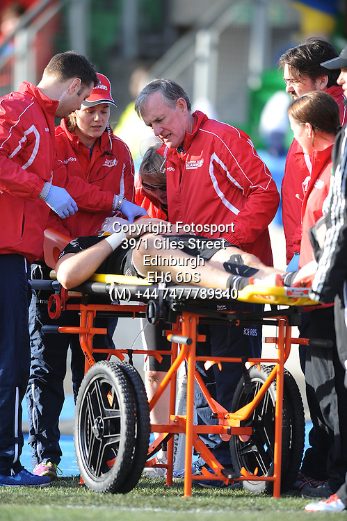 Tim Mikkelson - New Zealand is stretched off by the medics after injuring himself whilst scoring a try inthe corner.<br />New Zealand v South Africa, IRB Glasgow Sevens, Scotstoun stadium, Glasgow, Scotland, United Kingdom, Saturday 9 May 2015<br />Please credit: Fotosport/David Gibson