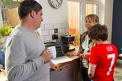 Mum Nancy, 43 and Dad Chris, 44, pictured with son Leo, 12, are able to manage their whole family's online demands thanks to BT Wifi. Real-life case study campaign, showcasing BT's complete Wi-Fi offering. London, May 16 2019.