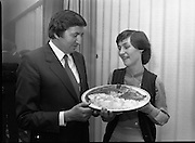 """The National Fish Cookery Award""..29.04.1982..04.29.1982.29th April 1982.1982..This competition sponsored by Bord Iascaigh Mhara was held in The Clare Inn, Newmarket-on Fergus,Co Clare. the competition was open to schools across the country..Minister Daly samples the winning entry with its creator Catherine O'Sullivan."