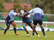 Kini Murimurivalu tries to break a tackle during the Fiji Training Session in preparation for the Rugby World Cup at London Irish RFC, Sunbury-On-Thames, United Kingdom on 14 September 2015. Photo by Ian Muir. during the Fiji Training Session in preparation for the Rugby World Cup at London Irish RFC, Sunbury-On-Thames, United Kingdom on 14 September 2015. Photo by Ian Muir.