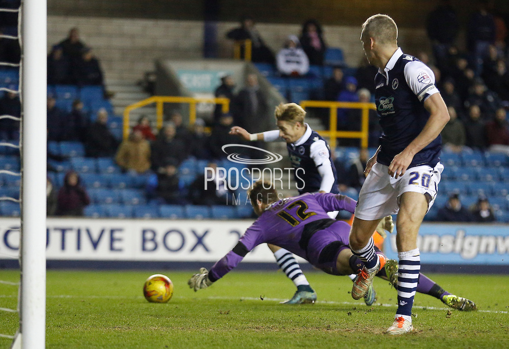 An error Colchester FC Goalkeeper Jamie Jones allows Millwall FC Midfielder Lee Martin a chance to pounce during the Sky Bet League 1 match between Millwall and Colchester United at The Den, London, England on 21 November 2015. Photo by Andy Walter.