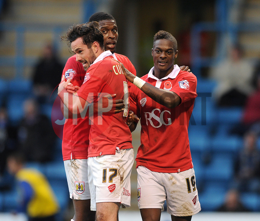 Bristol City's Greg Cunningham celebrates his goal with Bristol City's Jay Emmanuel-Thomas and Bristol City's Kieran Agard - Photo mandatory by-line: Dougie Allward/JMP - Mobile: 07966 386802 - 08/11/2014 - SPORT - Football - Gillingham - Priestfield Stadium - Gillingham v Bristol City - FA Cup - Round One