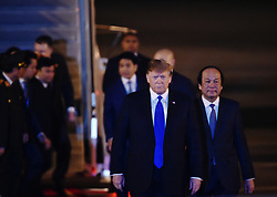 Feb. 26, 2019 - Hanoi, Vietnam - U.S. President DONALD TRUMP (front) arrives at an airport in Hanoi, Vietnam. Trump arrived in Vietnam's capital Hanoi on Tuesday night to meet with Kim Jong Un, top leader of the Democratic People's Republic of Korea. (Credit Image: © Xinhua via ZUMA Wire)