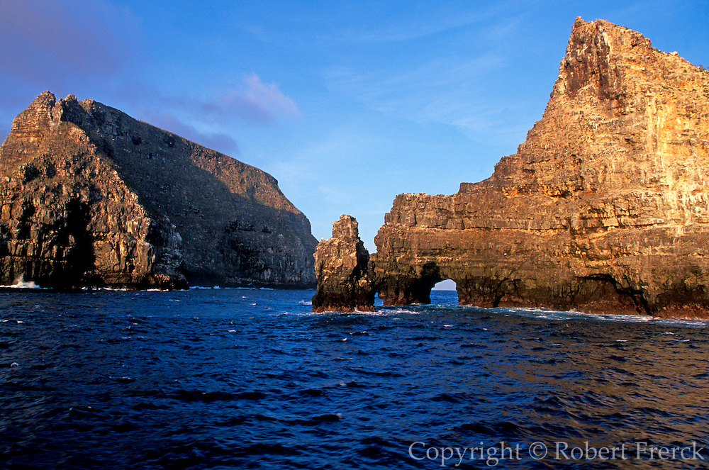 ECUADOR, GALAPAGOS ISLANDS sea arch and cliffs on Wolf Island