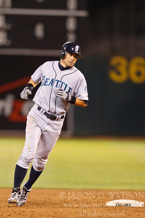 September 7, 2010; Oakland, CA, USA;  Seattle Mariners right fielder Ichiro Suzuki (51) rounds second base against the Oakland Athletics during the third inning at Oakland-Alameda County Coliseum.  Seattle defeated Oakland 7-5.