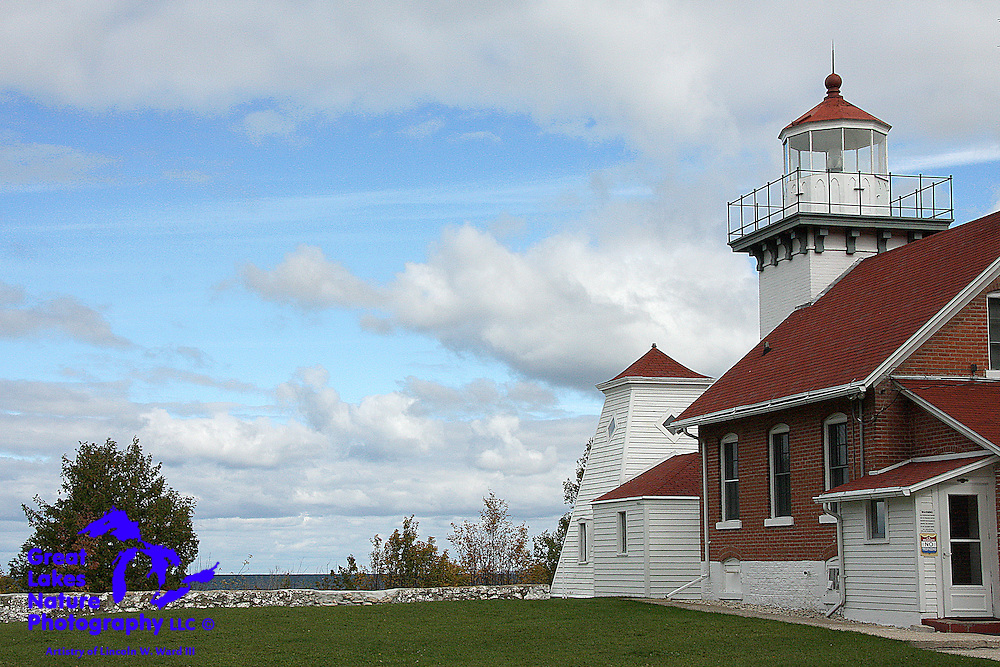 Sherwood Point Light, near Idlewild, Wisconsin, has been marking the west side of the north entrance to Sturgeon Bay since 1883. It was the last manned lighthouse on Lake Michigan when, in 1983, it was automated by the US Coast Guard. Local legend suggests that the lighthouse is haunted by the ghost of Minnie Hesh Cochems, one-time Assistant Keeper, and the wife of one-time Lighthouse Keeper William Cochems. The Cochems raised their family here. Minnie passed away, at the lighthouse, in 1928.
