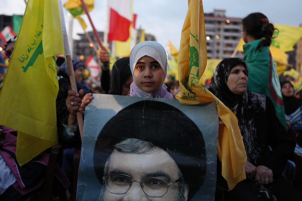 Supporters of the Shiite resistance and political group, Hizballah, rallied in the Dahiyeh southern suburbs of Beirut to watch a televised speech from Hizballah General Secretary Hassan Nasrallah. The rally was called for by Hizballah to celebrate Land Day, which is the 9th anniversary of Israel's withdrawal from southern Lebanon, which Hizballah and its supporters say was a victory over Israel. The rally comes just 13 days before Lebanese go to the polls to elect a new parliament. With Sunni Muslims and Shia Muslims mostly supporting their respective sectarian parties, Nasrallah praised Christian leader Michel Aoun. Aoun is head of the Free Patriotic Movement, which is allied with the Hizballah-led opposition March 8 coalition. ///A young Hizballah supporter holds a poster of Hassan Nasrallah.