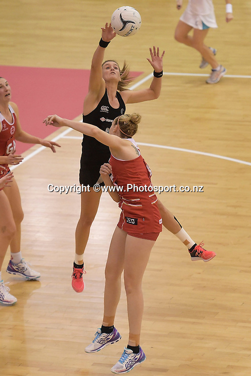 New Zealand's Leana de Bruin (Faceing) takes a pass with England's Jo Harten in defense during the Silver Ferns vs England netball match in Palmerston North on Friday the 31st of October 2014. Photo by Marty Melville/www.Photosport.co.nz