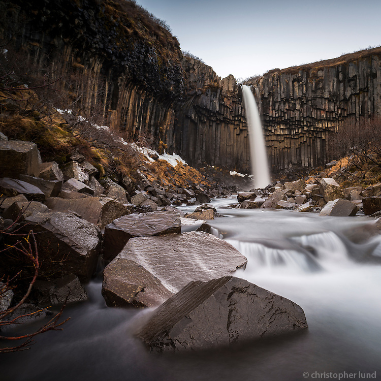 Svartifoss (Black Fall) waterfall in Skaftafell National Park in Iceland. The fall is surrounded by dark lava columns of Basalt, which gave rise to its name.