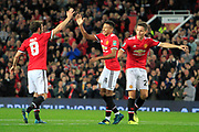 Manchester United midfielder Jesse Lingard (14) scores a goal to make the score 3-0 and celebrates with team-mates during the EFL Cup match between Manchester United and Burton Albion at Old Trafford, Manchester, England on 19 September 2017. Photo by Richard Holmes.