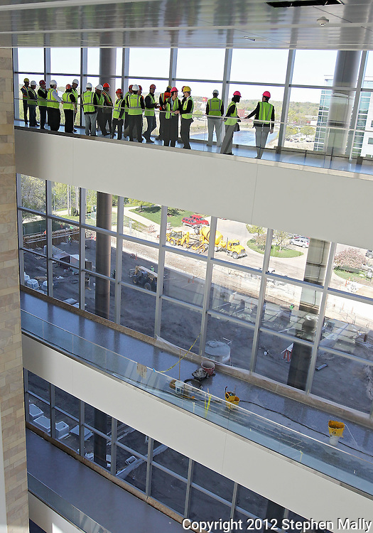 Cedar Rapids City Council members and Linn County Supervisors look over the lobby during a tour of the new Federal Courthouse in Cedar Rapids on Tuesday morning, April 10, 2012. (Stephen Mally/Freelance)