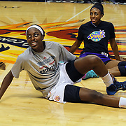 Sisters Chiney Ogwumike, (left), Connecticut Sun and Nneka Ogwumike, Los Angeles Sparks stretch before playing against each other for the fist time in the WNBA during the Connecticut Sun Vs Los Angeles Sparks WNBA regular season game at Mohegan Sun Arena, Uncasville, Connecticut, USA. 3rd July 2014. Photo Tim Clayton
