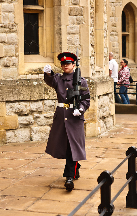 A palace guard marches in front of the building that holds the Crown Jewels at the Tower of London, London, England.