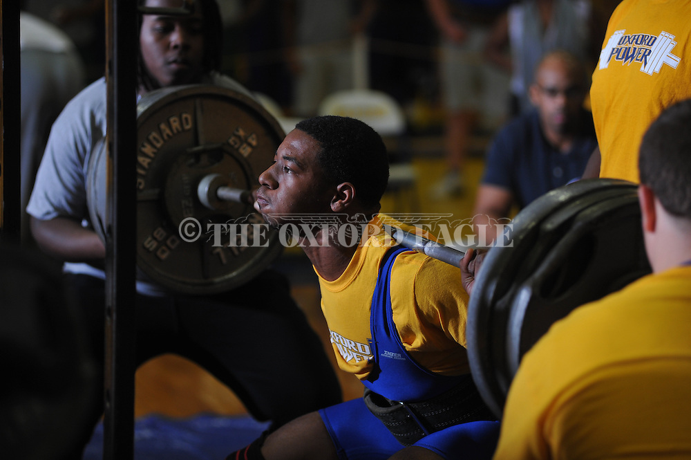 Kenzie Phillips squats during Class 5A Region weightlifting competition at Oxford High School in Oxford, Miss. on Saturday, February 9, 2013.