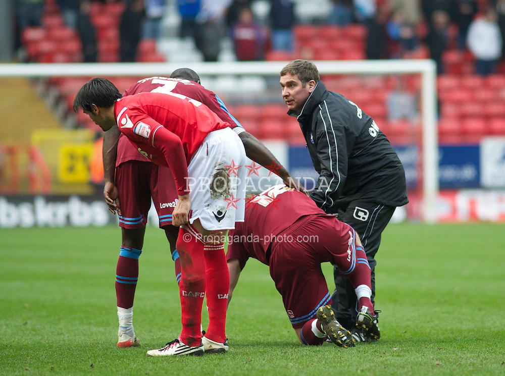 LONDON, ENGLAND - Saturday, March 5, 2011: Tranmere Rovers' Physio George Cain treats Ash Taylor for an injury during the Football League One match at The Valley. (Photo by Gareth Davies/Propaganda)