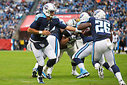 NASHVILLE, TN - NOVEMBER 29:  Marcus Mariota #8 hands off the ball to Antonio Andrews #26 of the Tennessee Titans during a game against the Oakland Raiders at Nissan Stadium on November 29, 2015 in Nashville, Tennessee.  The Raiders defeated the Titans 24-21.  (Photo by Wesley Hitt/Getty Images) *** Local Caption *** Marcus Mariota; Antonio Andrews