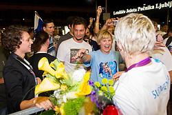 Gold judo medalist Urska Zolnir with her fans during reception of Slovenian Olympic team, on August 5, 2012 in Airport Joze Pucnik, Brnik, Slovenia. (Photo by Vid Ponikvar / Sportida.com)