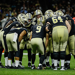 Aug 26, 2017; New Orleans, LA, USA; New Orleans Saints quarterback Drew Brees (9) huddles with running back Adrian Peterson (28) and teammates during the first half of a preseason game at the Mercedes-Benz Superdome. Mandatory Credit: Derick E. Hingle-USA TODAY Sports