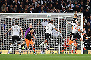 Derby County defender Cyrus Christie (2) heads the ball over the cross bar during the EFL Sky Bet Championship match between Derby County and Sheffield Wednesday at the iPro Stadium, Derby, England on 29 October 2016. Photo by Jon Hobley.