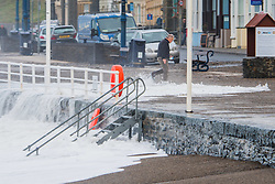 © London News Pictures. 16/12/2016. Aberystwyth, UK.<br /> Large aves to batter the seafront at Aberystwyth, and leaving a trail of sand and stones over the promenade and Marine Terrace road.  Photo credit: Keith Morris/LNP
