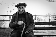 An elderly sits in the park.  Chania, Crete.