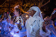 New York, NY - 31 October 2015. Drummers from the Batala NYC Samba Reggae Drum Band warm up in SoHo Square before the start of the annual Greenwich Village Halloween Parade. The Afro-Brazilian band is composed entirely of women.