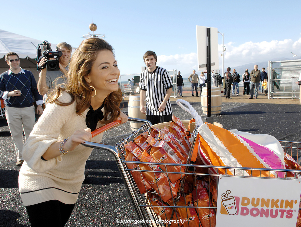 Television personality Maria Menounos pushes a cart full of Dunkin' Donuts packaged coffee during the first Dunkin' Donuts Shopping Cart Derby in Santa Monica, Calif. Menounos worked in Dunkin' Donuts stores for 6 years as a teenager in Mass. Photo/Dunkin' Donuts, Susan Goldman.