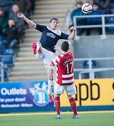 Falkirk's Stephen Kingsley over Hamilton's Lewis Longridge.<br /> half time : Falkirk 0 v 0 Hamilton, Scottish Championship game at The Falkirk Stadium. &copy; Michael Schofield 2014.