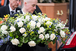 © Licensed to London News Pictures. 31/03/2018. Cambridge, UK. Flowers arrive at The funeral of Stephen Hawking at Church of St Mary the Great in Cambridge, Cambridgeshire. Professor Hawking, who was famous for ground-breaking work on singularities and black hole mechanics, suffered from motor neurone disease from the age of 21. He died at his Cambridge home in the morning of 14 March 2018, at the age of 76. Photo credit: Ben Cawthra/LNP