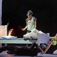 Picture shows : Simone James in background with match and fire.<br /> &copy; Picture Drew Farrell <br /> Tel : 07721-735041. <br /> '365'<br /> World Premiere<br /> National Theatre of Scotland&nbsp;<br /> Text&nbsp;by David Harrower<br /> 365 has been created especially for the Edinburgh International Festival by the National Theatre of Scotland's Artistic Director Vicky Featherstone and written by David Harrower, one of Scotland's leading playwrights.<br /> 365 follows the lives of a group of young people who with their humour, imagination, wit and raw courage pass through the practice flat, taking their first faltering steps towards adulthood and the outside world.<br /> A Practice Flat is one of the state's mechanisms to gently introduce these children to the adult world. 365 is the story of a practice flat - a purpose-built witness to hopes, dreams, fear, opportunity and memory.<br /> <br /> Vicky Featherstone Director?Georgia McGuinness Designer?Steven Hoggett Movement Director&nbsp;&nbsp;?Adrienne Quartly Sound designer?Colin Grenfell Lighting designer?Paul Buchanan Songs<br /> Playhouse  Theatre, Edinburgh.<br /> First performance Friday 22nd August until Saturday 25th August 2008.<br /> <br /> &copy; Picture Drew Farrell <br /> Tel : 07721-735041.