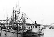 1979-Capt'n Junior Shrimp Boat docked in Kemah with Draw Bridge