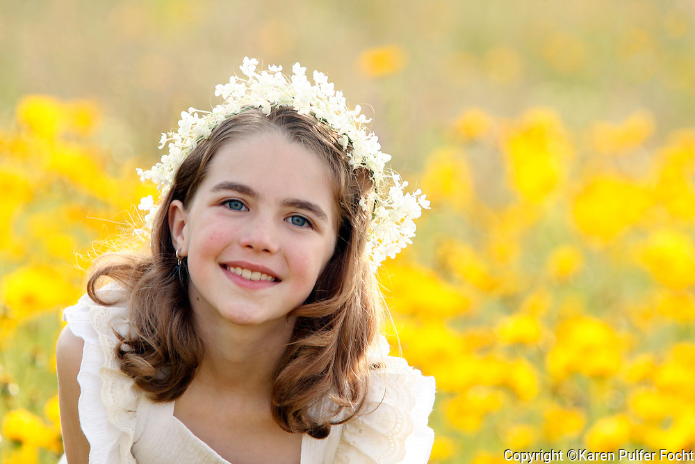 Portrait of a young girl in flowers.