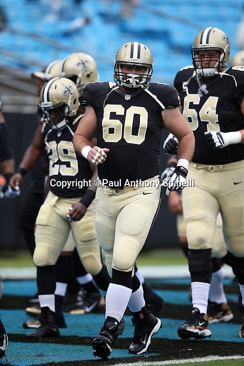 New Orleans Saints center Max Unger (60) warms up before the 2015 NFL week 3 regular season football game against the Carolina Panthers on Sunday, Sept. 27, 2015 in Charlotte, N.C. The Panthers won the game 27-22. (©Paul Anthony Spinelli)