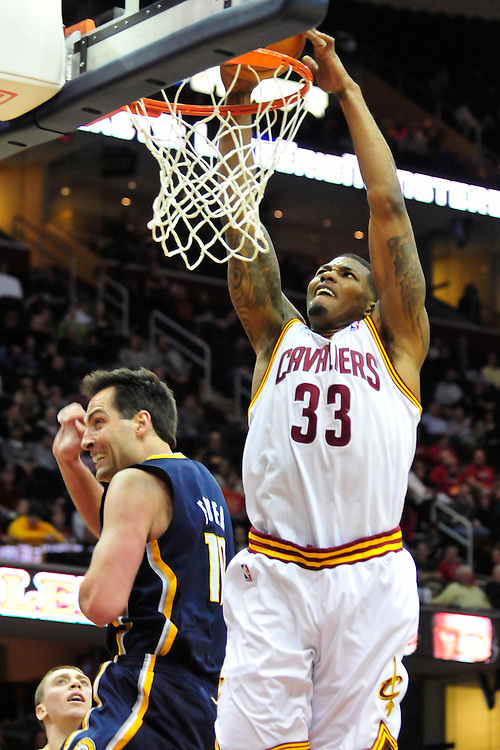 Feb. 2, 2011; Cleveland, OH, USA; Cleveland Cavaliers shooting guard Alonzo Gee (33) dunks over Indiana Pacers center Jeff Foster (10) during the first quarter at Quicken Loans Arena. Mandatory Credit: Jason Miller-US PRESSWIRE