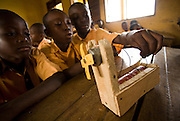 Children attend a science class where they use a makeshift battery-powered windmill at the Dahin-Sheli primary school in Tamale, northern Ghana, on Friday June 8, 2007.